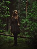 Girl standing in forest Stock Image