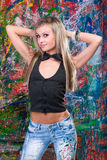 Girl standing in front of art graffiti Royalty Free Stock Photos