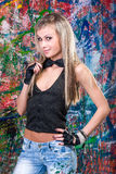 Girl standing in front of art graffiti Royalty Free Stock Photo