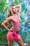 Girl standing in front of art graffiti Royalty Free Stock Photography