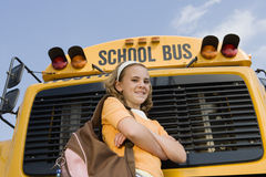 Girl Standing In Front Of Bus Royalty Free Stock Photos