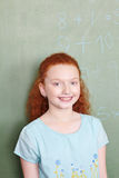 Girl standing in front of chalkboard Royalty Free Stock Photography