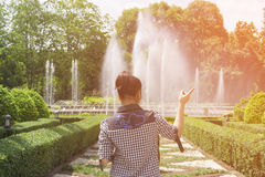 Girl standing in front of the fountain royalty free stock photos