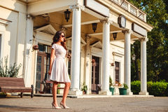 Girl standing in front of the old train station Stock Image