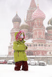 Girl standing in front of St. Basil's Cathedral Royalty Free Stock Images