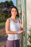 Girl standing at gate. Portrait royalty free stock images