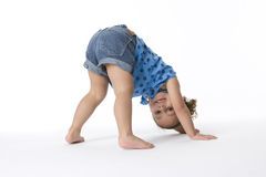 Girl on standing hands and feet Stock Photo