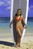 Girl standing with her paddle board Stock Photo