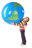 Girl standing and holding big inflatable globe Stock Photography