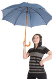 Girl standing and holding blue umbrella Royalty Free Stock Photo