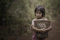 Girl standing hugging a custom made wooden basket.