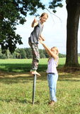Girl standing on iron pillar with thumb up Royalty Free Stock Images