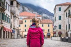Girl standing on the Kotor Old Town main square stock photo