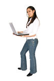 Girl standing with a laptop Stock Photography