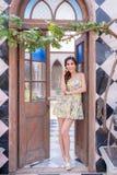 Girl standing lean door frame Stock Image