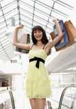 Girl standing in the mall after doing shopping Stock Photos
