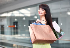 Girl standing in the mall after doing shopping Stock Images