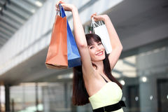 Girl standing in the mall after doing shopping Royalty Free Stock Image