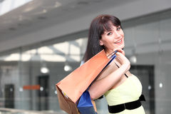 Girl standing in the mall after doing shopping Stock Image