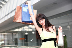 Girl standing in the mall after doing shopping Royalty Free Stock Photos