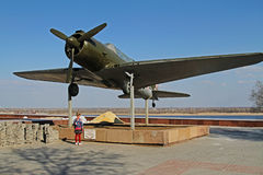 The girl is standing near airplane SU-2 BB-1 in Volgograd Royalty Free Stock Image