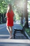 Girl standing near a bench Stock Photo