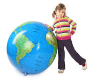 Girl standing near big inflatable globe Royalty Free Stock Photo