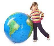 Free Girl Standing Near Big Inflatable Globe Royalty Free Stock Photo - 15656875