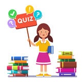 Girl standing near books and holding quiz placard Royalty Free Stock Photo