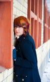 Girl Standing Near a Brick Wall Stock Photos