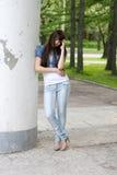 Girl Standing Near Column