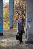 Girl standing near concrete post Royalty Free Stock Photo