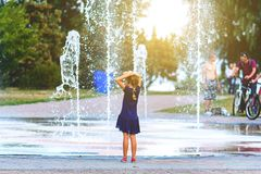 The girl is standing near the fountain Royalty Free Stock Photography