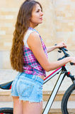 Girl standing near her bicycle Stock Photo