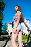 Girl standing near her bicycle Royalty Free Stock Photography