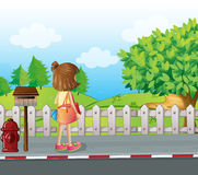 A girl standing near the mailbox at the roadside Royalty Free Stock Photography
