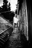 Girl standing near old grungy building Stock Photo