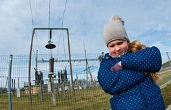 Girl standing near a power station, bad influence on people concept royalty free stock images