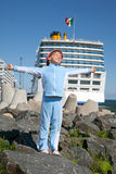 Girl standing near ship spread her arms Royalty Free Stock Photos