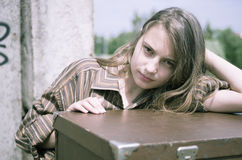 Girl standing near the suitcase Royalty Free Stock Image