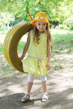 Girl standing near tire swing Stock Images