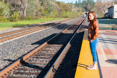 Girl Standing Near Train Rails Royalty Free Stock Photos