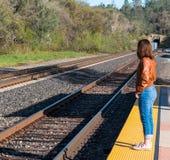Girl Standing Near Train Rails Stock Photos