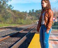 Girl Standing Near Train Rails Royalty Free Stock Photo