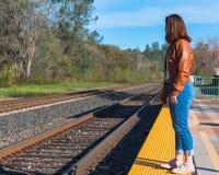 Girl Standing Near Train Rails Stock Photography