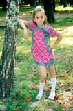 Girl standing near tree Royalty Free Stock Photo