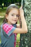 Girl standing near tree Stock Photos