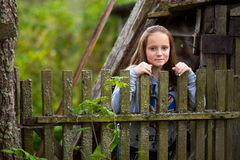 Girl standing near vintage rural fence Royalty Free Stock Images