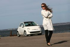 Girl standing next to the car Royalty Free Stock Images