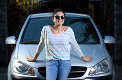 Girl standing next to car Royalty Free Stock Photo